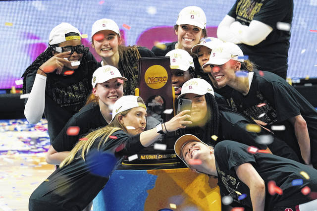 Stanford players celebrate with the trophy after the championship game against Arizona in the women's Final Four NCAA college basketball tournament on Sunday at the Alamodome in San Antonio. Stanford won 54-53.