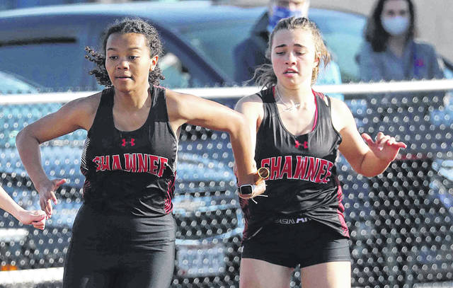 Sabrie Bodden hands off to Mariah Richardson for Shawnee in the girls 400 meter relay during Friday night's Redskin Relays at Wapakoneta.