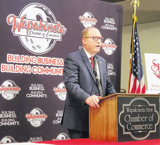 Aaron Rex, the superintendent for Wapakoneta schools, speaks at the Eagles on Thursday in the Wapakoneta Chamber of Commerce's annual update from city, county and school officials.