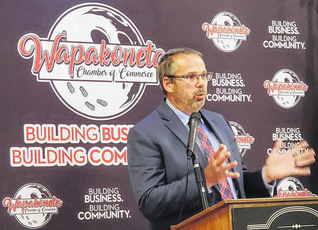 Auglaize County Commissioner Doug Spencer speaks at the Eagles on Thursday in the Wapakoneta Chamber of Commerce's annual update from city, county and school officials.