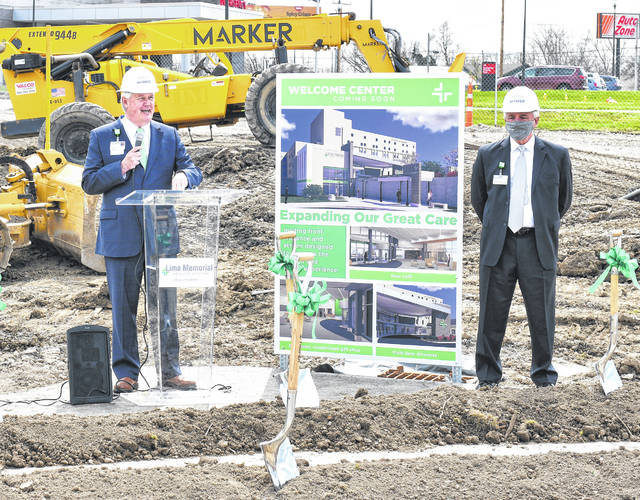 Mike Swick, President and CEO of Lima Memorial, speaks alongside John Johnson during a ceremony to officially commemorate the beginning of construction for its new Welcome Center on Wednesday.