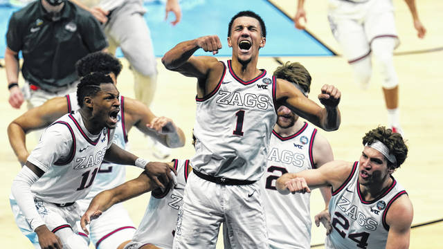 Gonzaga guard Jalen Suggs (1) celebrates making the game winning basket against UCLA during overtime in a men's Final Four NCAA college basketball tournament semifinal game Saturday night at Lucas Oil Stadium in Indianapolis. Gonzaga won 93-90 on his 3-pointer from just inside half court as time ran out.