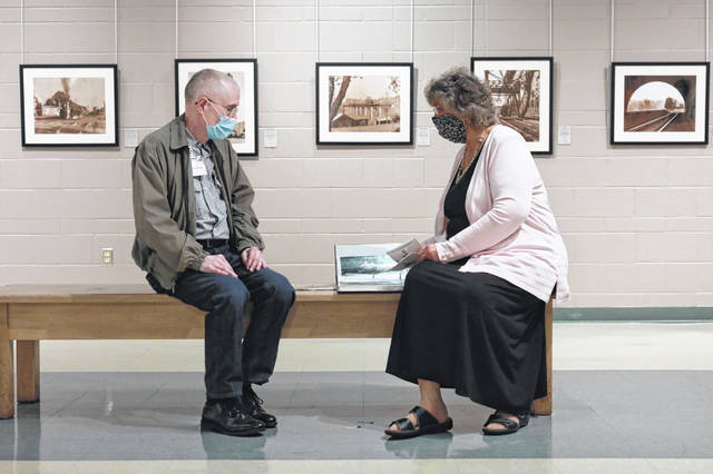 "John Keller and Marianne York enjoy the new exhibit at the Allen County Museum, ""Richard Cook: Rail Images of a Past Era."""