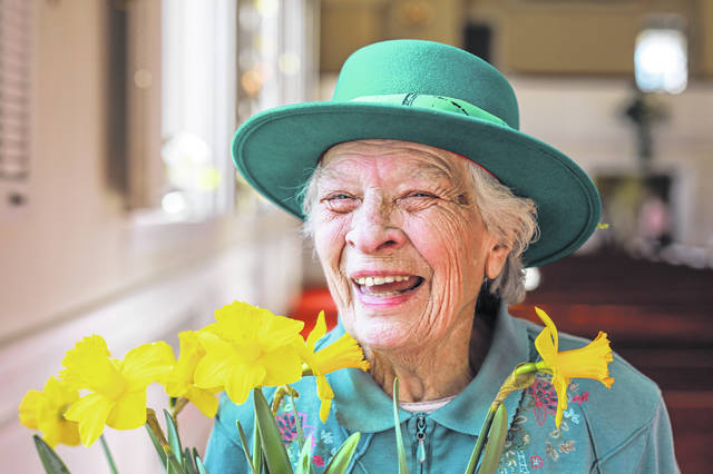 Marilyn Stockton smiles with her flowers after the Easter service Sunday morning at Market Street Presbyterian Church in Lima.