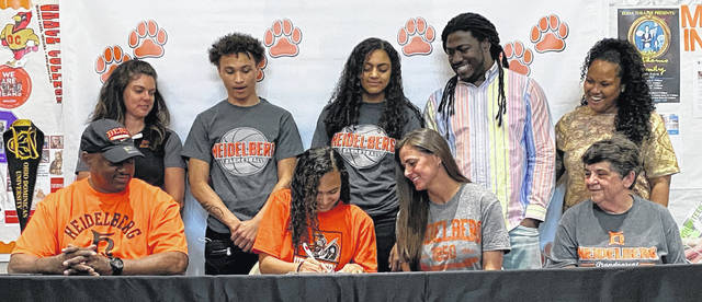 Elida's Amira Freeman has signed her letter of intent to play basketball for Heidelberg. Among those attending the signing were, from left, front row dad, Jimmie Freeman, Amira, mom, Trisha Lauck, grandmother Judy Hey, back row, Elida Coach Elise Jenkins, boyfriend Isaiah Sanders, sister Addisyn Freeman, brother Austin Freeman and his fiancee, Dystany. Photo provided