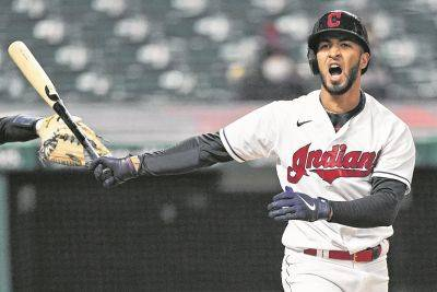 The Indians' Eddie Rosario reacts after striking out during Thursday night's game against the New York Yankees in Cleveland.