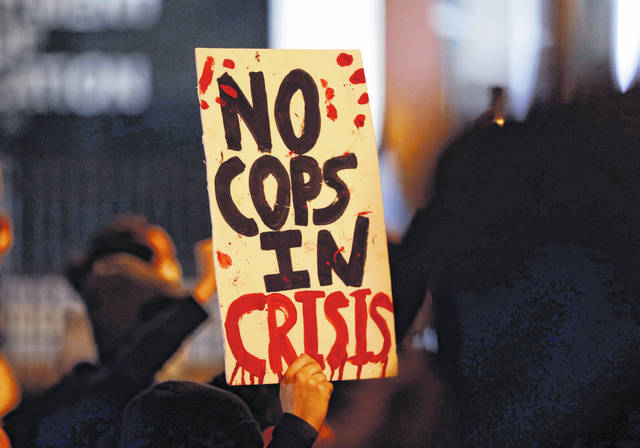 Protesters march up North Front Street on April 13 in Columbus, demonstrating against the fatal shooting of a Black man shot and killed by police in Westerville, Ohio.