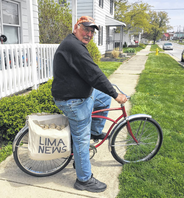 Steve Metzger of Elida has restored this 1967 Schwinn carrier bike that was similar to the one he used to deliver newspapers as a youth. He's even made saddle bags for it and vows to one day ride it around the community.
