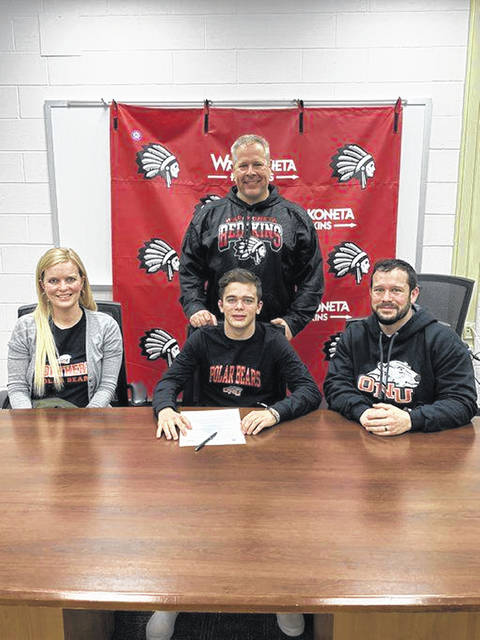 Joining Wapakoneta's Colin Mellot for his signing to wrestle at Ohio Northern University were, sitting, from left, mom, Stephanie, Colin, dad, Chris and, standing, Wapakoneta coach Jason Rostorfer.