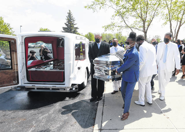 Pallbearers carry the casket for Ma'Khia Bryant following the funeral Friday for the 16-year-old at the First Church of God in Columbus. Bryant was fatally shot by a Columbus police officer during an altercation on April 20.