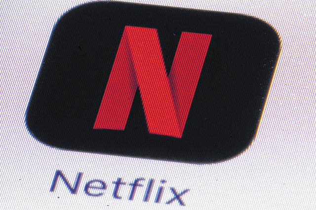 The Netflix logo is shown July 17, 2017, on an iPhone in Philadelphia. Streaming services ranging from Netflix to Disney+ want us to stop sharing passwords. That's the new edict from the giants of streaming media, who hope to discourage the common practice of sharing account passwords without alienating their subscribers, who've grown accustomed to the hack.