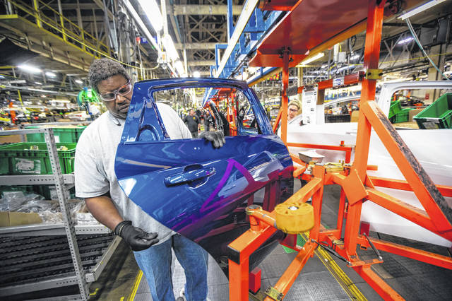 General Motors employees work on the assembly line April 26, 2019, at Fairfax Assembly & Stamping Plant in Kansas City, Kansas. Fairfax Assembly & Stamping Plant has been down since early February because of the chip woes.