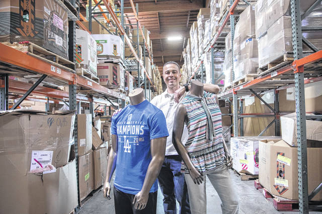 John Traches, who runs JT's Merchandise Outlet in Santa Fe Springs, Calif., has created a thriving business reselling items during the pandemic. Photographed at JT's Merchandise Outlet on April 27 in Santa Fe Springs, CA.