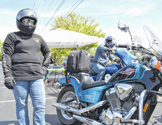 Ashley Cover gets ready to get on her Honda Shadow at the annual Blessing of the Bikes on Sunday at Shawnee United Methodist Church.