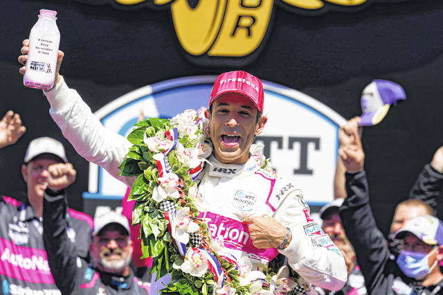 Helio Castroneves of Brazil celebrates after winning the Indianapolis 500 auto race for the fourth time in his career at the Indianapolis Motor Speedway in Indianapolis on Sunday.