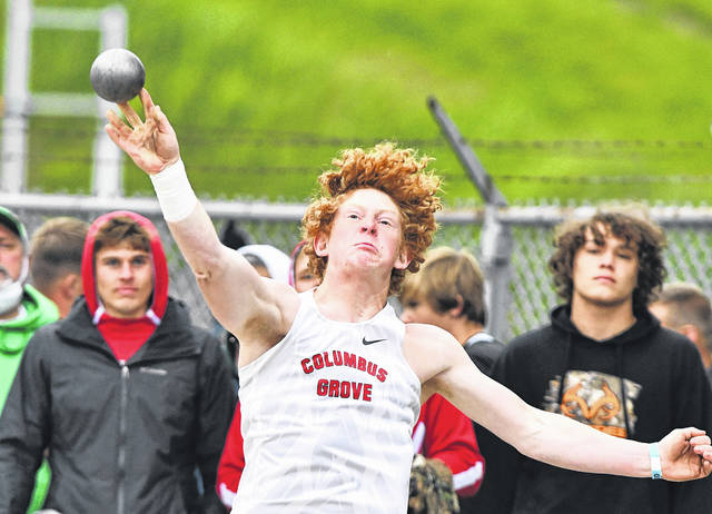 Columbus Grove's A.J. Schafer competes in the shot put during Friday's Division III regional at Frost-Kalnow Stadium in Tiffin. See more track and field photos at LimaScores.com.