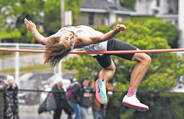 Columbus Grove's Zeke Halker competes in the high jump during Friday's Division III regional at Frost-Kalnow Stadium in Tiffin.