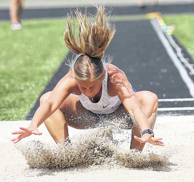 Addison Mueller of Delphos St. John's competes in the long jump during Saturday's Spencerville Division III district.