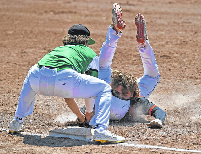 Celina's Conner Altstaetter tags out Elida's Brady Kirk at third base during Saturday's game at Ed Sandy Field.