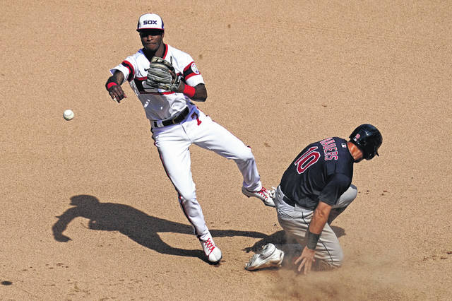 Chicago White Sox shortstop Tim Anderson, left, throws to first after forcing out the Cleveland Indians' Jake Bauers during the sixth inning of a baseball game in Chicago on Sunday.