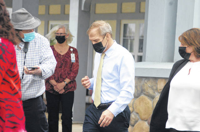 U.S. Rep. Jim Jordan, center, exits Elmwood Assisted Living of New Bremen on Tuesday afternoon.