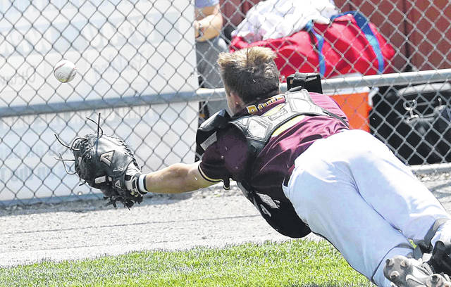 A foul ball is out of diving Kalida catcher Gabe Roof's reach during a Thursday Division IV district semifinal against Wayne Trace at Patrick Henry.