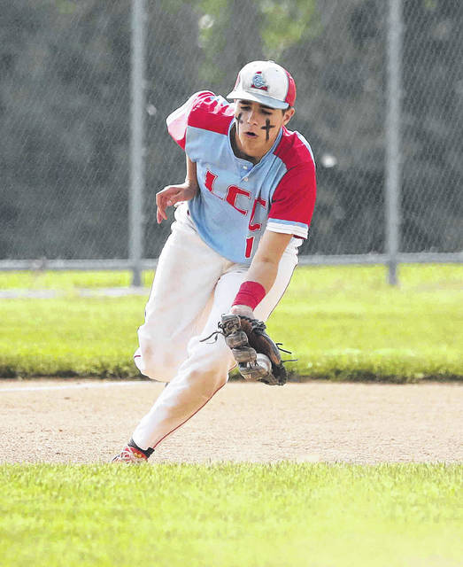 Lima Central Catholic's Braden Tarr scoops up a ground ball during Thursday's Division IV sectional final against St. Henry at Lima Central Catholic.