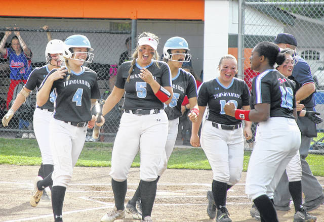 Teammates congratulate Lima Central Catholic's Mary Kate Dee (4) after she hit a three-run home run during Friday's Division IV district final Friday against Wayne Trace at Elida.