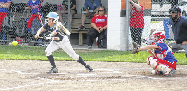 Lima Central Catholic's Madeline Quatman looks to lay down a bunt during Friday's Division IV district final against Wayne Trace at Elida.