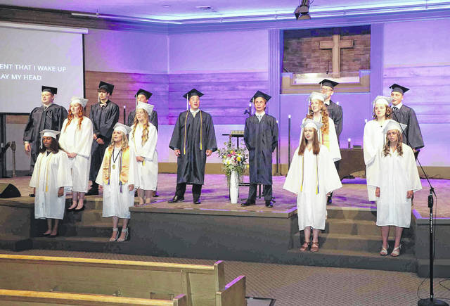 The senior class performs a song May 28 during the graduation ceremony at Lima Temple Christian School High School.