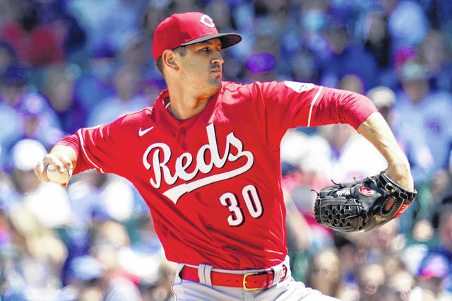 Cincinnati Reds starting pitcher Tyler Mahle throws against the Chicago Cubs during the first inning of a baseball game in Wrigley Field in Chicago on Sunday.