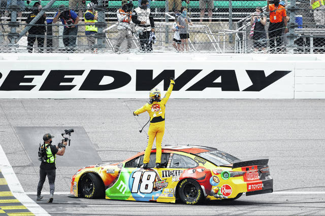 Kyle Busch reacts after winning a NASCAR Cup Series auto race at Kansas Speedway in Kansas City, Kan., on Sunday on his 36th birthday.
