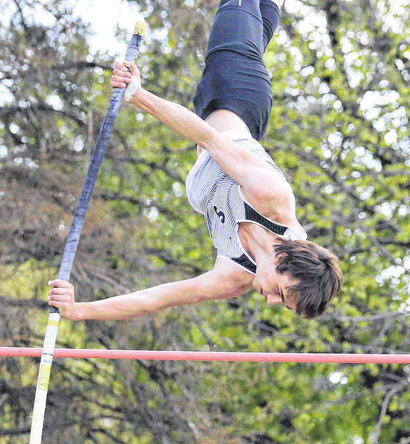 Dale Smith from Spencerville clears the bar in the pole vault Thursday at the Northwest Conference Championships at Columbus Grove.