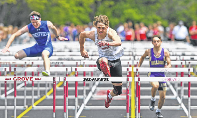 Columbus Grove's Jon Banal competes in the 110 meter hurdles during Saturday's Northwest Conference Meet at Columbus Grove. See more track and field photos at LimaScores.com.