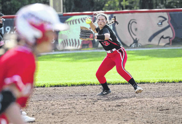 Shawnee's Payton Modschiedler gets ready to throw to first as Wapakoneta's Carlie Schroeder runs toward the base during Friday night's game at Shawnee.