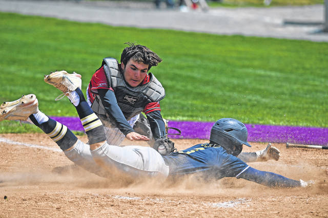 Tiffin Columbian's Brayden Tucker reaches home plate against Shawnee's Derek Lyons during Saturday's Division II district final at Bluffton University. See more high school baseball photos at LimaScores.com.