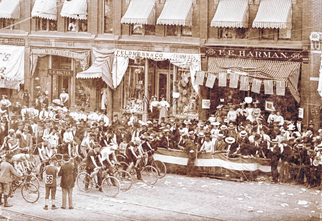 A large bicycle race can be seen in this 1896 photograph, with its starting line in front of the Harman store along North Main Street.