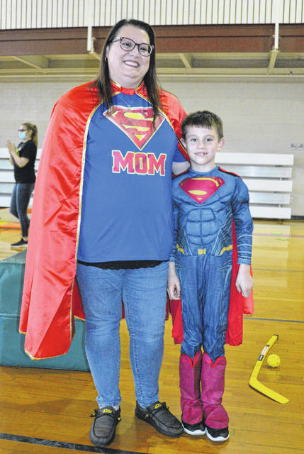 Super-mom Crystal Braun and her son, Gideon, have a super great time at the YMCA, Saturday night.