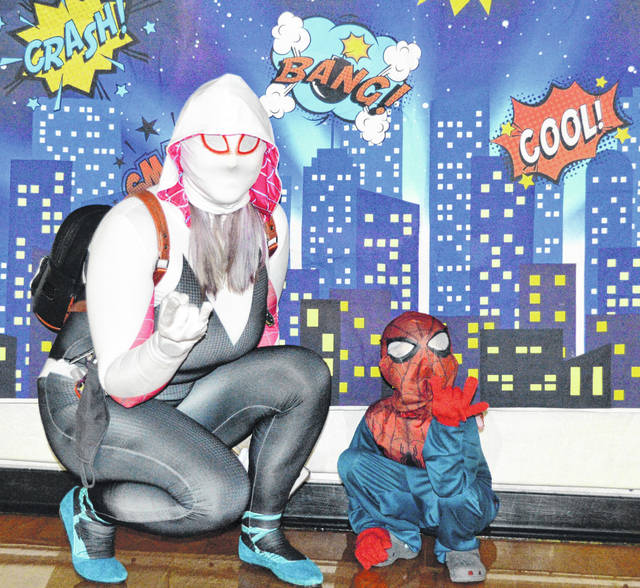 Nikki Bartlett and her son, Dorian Zapata, attended their first mother-son superhero party Saturday at the Lima YMCA.