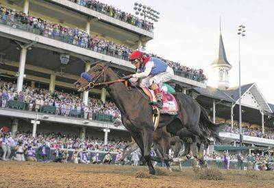 John Velazquez riding Medina Spirit crosses the finish line Saturday to win the 147th running of the Kentucky Derby at Churchill Downs.