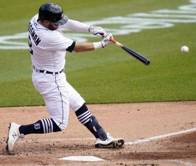 The Tigers' Robbie Grossman connects for an RBI single during the second inning of Thursday's game against Kansas City in Detroit. (AP photo)