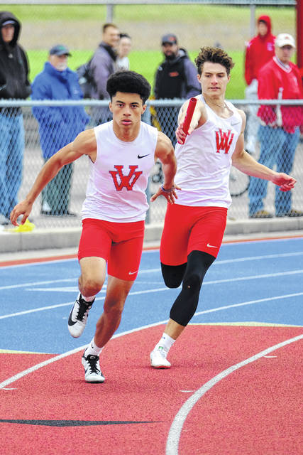 Van Wert's Ethan Brown hands the baton to Nate Phillips during Saturday's Division II regional in Piqua.