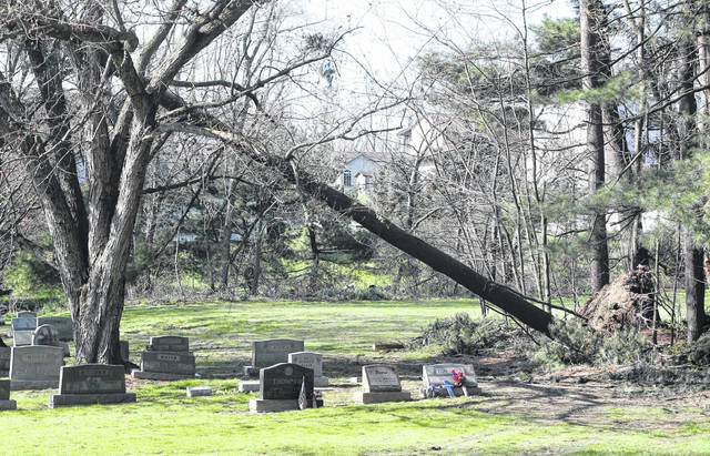 Severe storm damage is visible April 15, 2020, in multiple sections of Brookfield Cemetery in Tuscarawas Township.