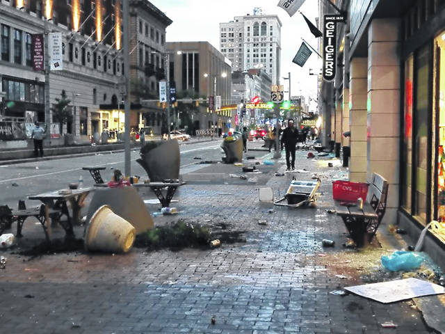 Rioters damaged buildings on Euclid Avenue on May 30 in downtown Cleveland.