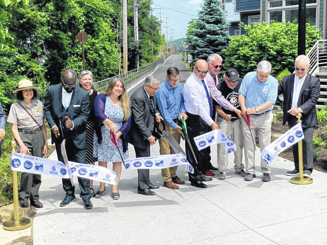 Officials cut a ribbon June 9, marking the completion of the Towpath Trail in Cleveland.