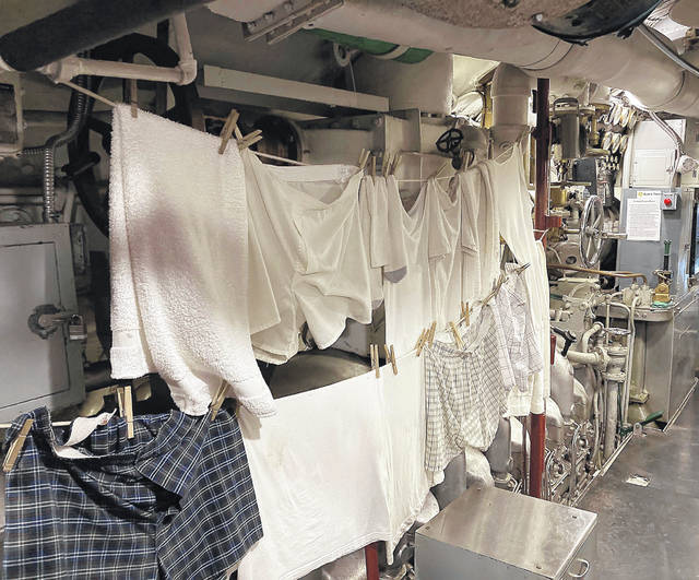 Clothes dry in the engine room of the U.S.S. Cod, as seen in this May 24 photo. The display attempts to provide a realistic look at life aboard the World War II submarine.