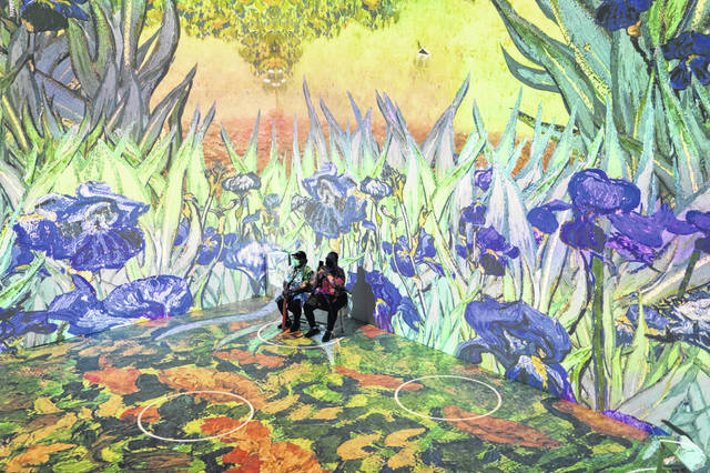 Projections of selected works of celebrated painter Vincent Van Gogh are displayed June 4 at a preview of the Immersive Van Gogh exhibit at Pier 36 in New York.