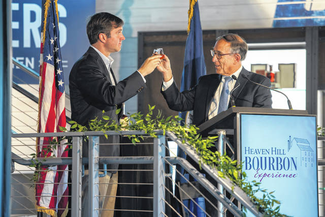 Kentucky Gov. Andy Beshear, left, joins Heaven Hill Brands President Max L. Shapira on June 14 to toast the new Heaven Hill Bourbon Experience in Bardstown, Ky. Heaven Hill Distillery recently opened the $19 million tourist center in Kentucky bourbon country.