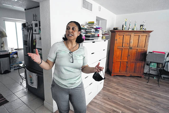 Cristina Livingston recounts the problems she has had in her apartment June 18, including a leaking ceiling and mold, at her home in Bay Harbor Islands, Fla. The Biden administration on June 24 extended the nationwide ban on evictions for a month to help millions of tenants unable to make rent payments during the coronavirus pandemic but said this is expected to be the last time it does so. Livingston, mother of two, who had lost her administrative assistant job during the pandemic, said she was relieved to hear it had been extended.