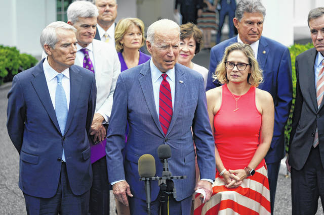 President Joe Biden, with a bipartisan group of Senators, speaks June 24 outside the White House in Washington. Biden invited members of the group of 21 Republican and Democratic senators to discuss the infrastructure plan.